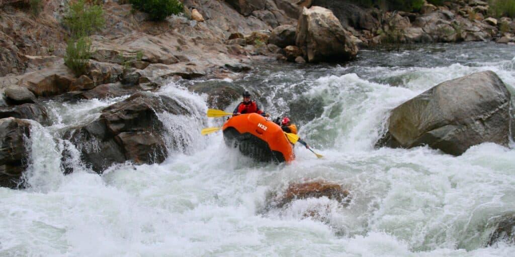 going through rapids in a raft Sierra South Mountain Sports Kern River California
