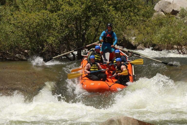 rafters and guide manage through strong whitewater rapids Sierra South Mountain Sports Kern River California